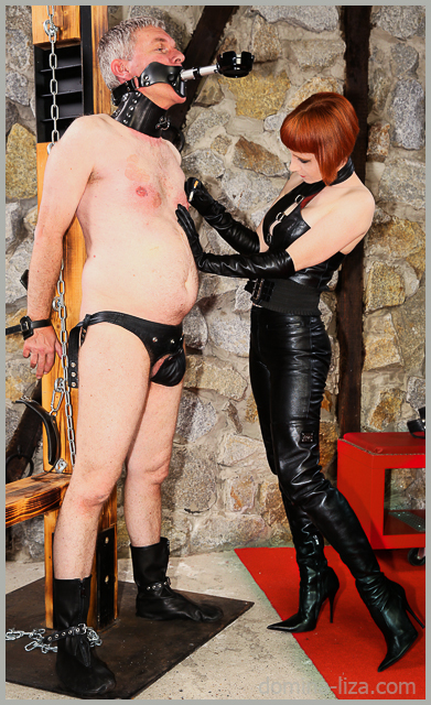 Domina Liza after whipping her chained slave